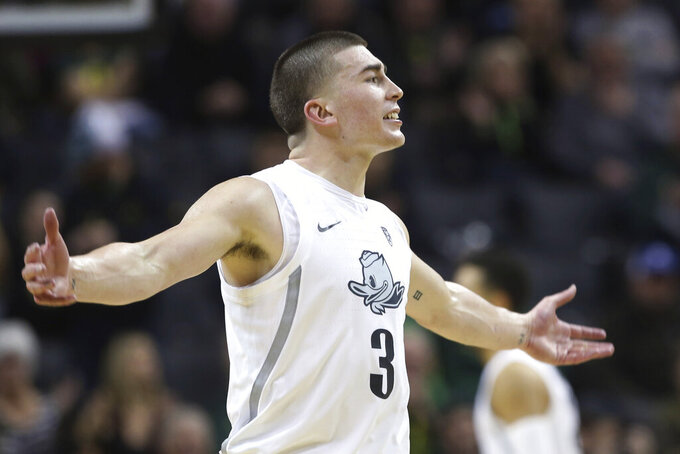 Oregon's Payton Pritchard celebrates with fans after making a 3-point shot against Colorado during the second half of an NCAA college basketball game in Eugene, Ore., Thursday, Feb. 13, 2020. (AP Photo/Chris Pietsch)