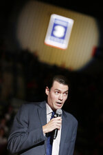 Former NBA and Gonzaga player Adam Morrison speaks under a banner with his jersey as the school honors him before an NCAA college basketball game between Gonzaga and San Diego in Spokane, Wash., Thursday, Feb. 27, 2020. (AP Photo/Young Kwak)