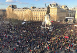 Tens of thousands of people gather on the Place de la Republique after they marched peacefully to urge faster government action against global warming, Saturday, March 16, 2019 in Paris. Families, activists, performers and politicians were among the 30,000 people who demonstrated Saturday in a march from the famed Opera Garnier to the Republic Plaza. It was among dozens of climate actions around France the day after worldwide student climate strikes. (AP Photo/Milos Krivokapic)