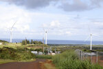 This Oct. 30, 2019, photo shows wind turbines spinning near where protesters are fighting against the construction of eight other taller turbines in Kahuku, Hawaii. The ongoing protest by mostly Native Hawaiians stalling construction of a $1.4-billion telescope on the Big Island has inspired protests on Oahu, the state's most populous island, with efforts to block the turbines and to stop the redevelopment of a beach park. (AP Photo/Jennifer Sinco Kelleher)