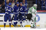 Dallas Stars goaltender Anton Khudobin, of Kazakhstan, reacts as members of the Tampa Bay Lightning, from left, Brayden Point, Steven Stamkos, and Ondrej Palat, of the Czech Republic, celebrate a goal during the first period of an NHL hockey game Thursday, Feb. 14, 2019, in Tampa, Fla. (AP Photo/Mike Carlson)