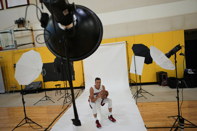 Miami Heat's Duncan Robinson poses for a photographer during the NBA basketball team's Media Day in Miami, Monday, Sept. 27, 2021. (AP Photo/Rebecca Blackwell)