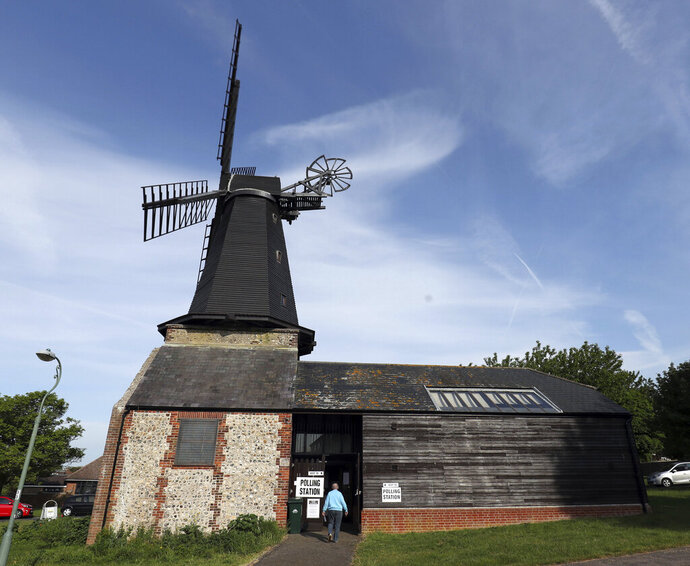A woman arrived at a polling station located in West Blatchington Windmill near Hove, south east England, Thursday May 23, 2019, as polls opened in elections for the European Parliament. (Steve Parsons/PA via AP)
