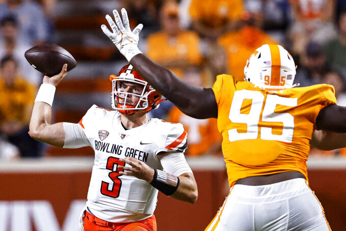 Bowling Green quarterback Matt McDonald (3) throws to a receiver as Tennessee's Da'Jon Terry (95) defends during the second half of an NCAA college football game Thursday, Sept. 2, 2021, in Knoxville, Tenn. (AP Photo/Wade Payne)