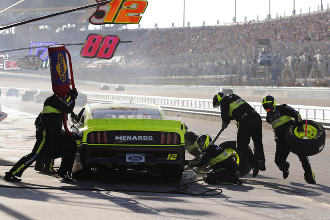 Ryan Blaney takes a pit stop during a NASCAR Cup Series auto race at Homestead-Miami Speedway in Homestead, Fla., Sunday, Nov. 17, 2019. (AP Photo/Luis M. Alvarez)