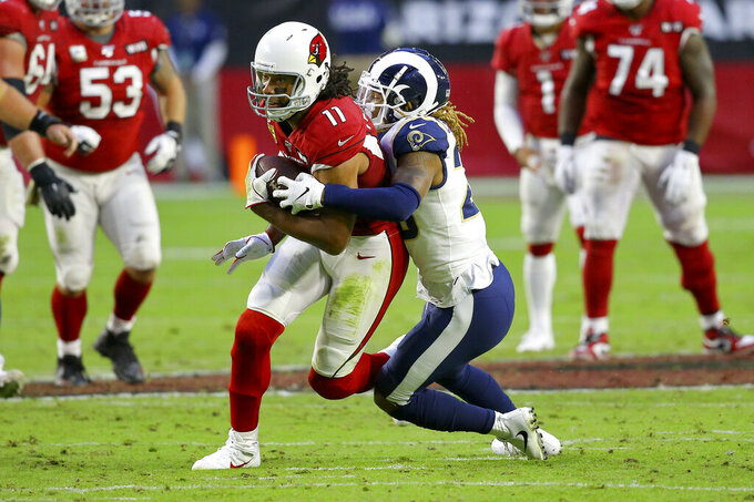 Arizona Cardinals wide receiver Larry Fitzgerald (11) is tacked by =l2during the second half of an NFL football game, Sunday, Dec. 1, 2019, in Glendale, Ariz. (AP Photo/Ross D. Franklin)