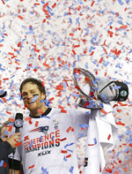 FILE - In this Jan. 18, 2015, file photo, New England Patriots quarterback Tom Brady holds up the championship trophy after the NFL football AFC Championship game against the Indianapolis Colts, in Foxborough, Mass. Two things have been consistent for Patriots over the past decade: Tom Brady and reaching the AFC championship game. The Patriots' 40-year-old quarterback will try to lead his team to a place in its seventh straight conference title game when it hosts the Titans. (AP Photo/Julio Cortez, File)