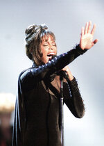 """FILE - Whitney Houston performs during the 21st American Music Awards at the Shrine Auditorium in Los Angeles on Feb. 7, 1994. Houston,  who died in 2012, is nominated for a 2020 Billboard Music Award for top dance/electronic song for """"Higher Love,"""" her platinum collaboration with Norwegian DJ-producer Kygo. She originally released a cover of Steve Winwood's """"Higher Love"""" as a Japan-only bonus track on her 1990 album """"I'm Your Baby Tonight,"""" but Kygo's dance remix of the song became an international hit after it was released last year. (AP Photo/Mark J. Terrill, File)"""