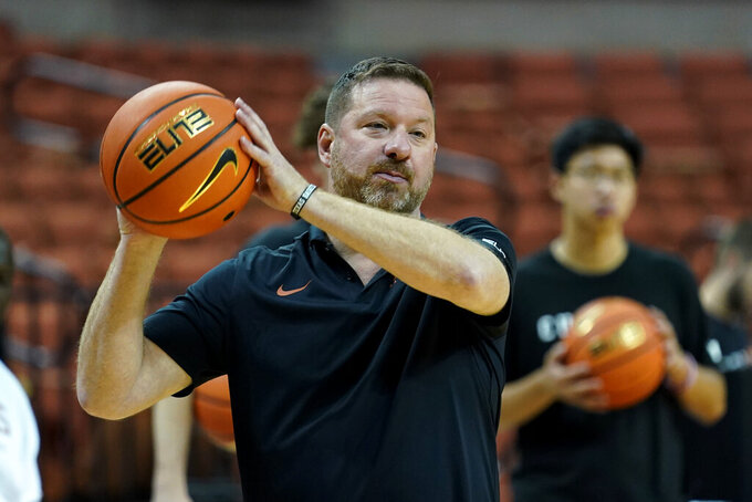 In this Tuesday, Oct. 19, 2021, photo, Texas head coach Chris Beard directs a practice at the team's facility, in Austin, Texas. New coach Chris Beard leads Texas into his first season with a lineup built through the transfer portal. (AP Photo/Eric Gay)