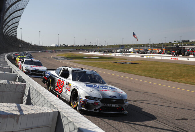 Chase Briscoe (98) hugs the inside of Turn 1 in a NASCAR Xfinity Series auto race, Saturday, July 27, 2019, at Iowa Speedway in Newton, Iowa. Briscoe won the race. (AP Photo/Matthew Putney)