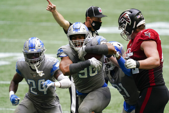 Detroit Lions defensive end Trey Flowers (90) celebrates during the second half of an NFL football game against the Atlanta Falcons, Sunday, Oct. 25, 2020, in Atlanta. (AP Photo/Brynn Anderson)