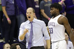 Washington coach Mike Hopkins, left yells toward an official as Isaiah Stewart (33) heads to the bench after collecting his third foul against Montana during the first half of an NCAA college basketball game Friday, Nov. 22, 2019, in Seattle. (AP Photo/Elaine Thompson)