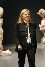 Designer Tory Burch greets the crowd after showing her collection during Fashion Week in New York, Sunday, Feb. 9, 2020. (AP Photo/Seth Wenig)