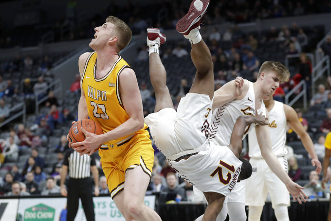 Loyola of Chicago's Marquise Kennedy (12) takes a tumble over Valparaiso's Ben Krikke, front, during the first half of an NCAA college basketball game in the quarterfinal round of the Missouri Valley Conference men's tournament Friday, March 6, 2020, in St. Louis. (AP Photo/Jeff Roberson)