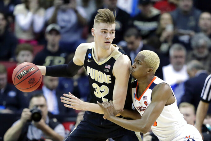 FILE - In this March 30, 2019, file photo, Purdue's Matt Haarms (32) is defended by Virginia's Mamadi Diakite (25) during the first half of a regional final against Virginia in the NCAA college basketball tournament in Louisville, Ky. The Boilermakers could revert to their big lineup with 7-foot-3 center Matt Haarms, 270-pound power forward Trevon Williams, 6-9 small forward Aaron Wheeler and 6-7 guard Nojel Eastern.  (AP Photo/Michael Conroy, File)