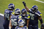 Seattle Seahawks tight end Jacob Hollister (86) celebrates with teammates after he caught a pass for a touchdown against the Los Angeles Rams during the second half of an NFL football game, Sunday, Dec. 27, 2020, in Seattle. (AP Photo/Elaine Thompson)