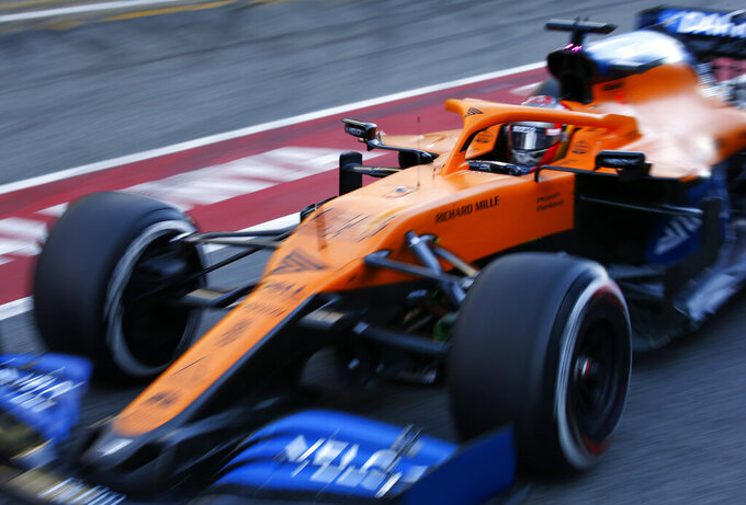 Mclaren driver Carlos Sainz of Spain pulls out of the pit lane during the Formula One pre-season testing session at the Barcelona Catalunya racetrack in Montmelo, outside Barcelona, Spain, Friday, Feb. 28, 2020. (AP Photo/Joan Monfort)