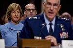 Gen. John Hyten, right, accompanied by his wife Laura, left, speaks before the Senate Armed Services Committee on Capitol Hill in Washington, Tuesday, July 30, 2019, for his confirmation hearing to be Vice Chairman of the Joint Chiefs of Staff. (AP Photo/Andrew Harnik)