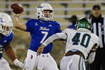 Tulsa quarterback Davis Brin (7) throws a pass while under pressure from Tulane linebacker Nick Anderson (40) during the second half of an NCAA college football game in Tulsa, Okla., Thursday, Nov. 19, 2020. (AP Photo/Sue Ogrocki)