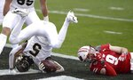 Wake Forest wide receiver Jaquarii Roberson tumbles into the end zone for a touchdown as Wisconsin safety Scott Nelson, right, falls to the turf during the Duke's Mayo Bowl NCAA college football game at Bank of America Stadium in Charlotte, N.C., Wednesday, Dec. 30, 2020. (Jeff Siner/The News & Observer via AP)