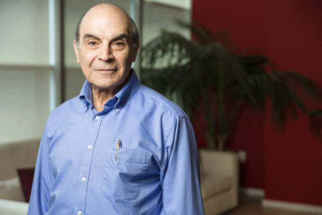 FILE  - In this Friday, June 27, 2014  filephoto, David Suchet poses for a portrait during an interview in Los Angeles.  Suchet, who played Agatha Christie's Hercule Poirot on television for almost 25 years has been knighted for services to entertainment in the Queen's Birthday honor list, it was announced late Friday, Oct. 9, 2020. (Photo by Casey Curry/Invision/AP, File)