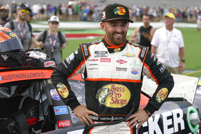Austin Dillon stands by his car before the NASCAR Cup Series auto race at Daytona International Speedway, Saturday, Aug. 28, 2021, in Daytona Beach, Fla. (AP Photo/John Raoux)