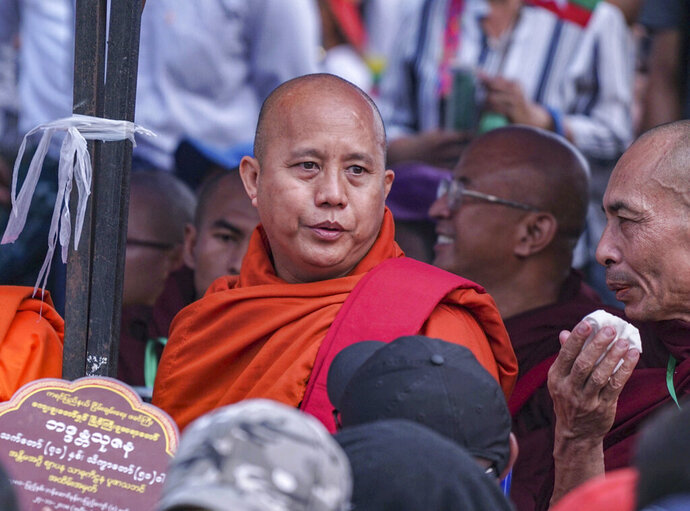 In this May 5, 2019, photo, Buddhist monk and anti-Muslim community leader Wirathu is seen during a nationalist rally in Yangon, Myanmar. A court issued Wednesday, May 29, 2019, an arrest warrant for the Buddhist monk famous for his incendiary comments about the country's Muslim minority and criticisms of the government. The warrant issued in Yangon charges Wirathu with sedition for remarks he made on May 5 about the government of Myanmar's leader, Aung San Suu Kyi. (AP Photo/Aung Naing Soe)