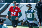 Philadelphia Eagles quarterback Carson Wentz, left, comes out to the field with wide receiver Quez Watkins, right, during an NFL football practice, Sunday, Aug. 30, 2020, in Philadelphia. (AP Photo/Chris Szagola, Pool)