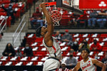 Texas Tech's Tyreek Smith (10) dunks during the first half of an NCAA college basketball game against Troy, Friday, Dec. 4, 2020, in Lubbock, Texas. (AP Photo/Brad Tollefson)