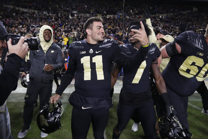 Purdue quarterback David Blough (11) celebrates at the end an NCAA college football game against Ohio State in West Lafayette, Ind., Saturday, Oct. 20, 2018. Purdue defeated Ohio State 49-20. (AP Photo/Michael Conroy)