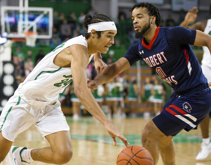 Marshall's Cam Books-Harris (24) attempts to drive the baseline against Robert Morris' Josh Williams (0) during an NCAA college basketball game Thursday, Nov. 7, 2019, in Huntington, W.Va. (Sholten Singer/The Herald-Dispatch via AP)