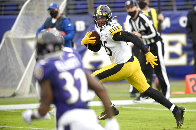 Pittsburgh Steelers tight end Eric Ebron (85) runs with the ball before scoring a touchdown on a pass from quarterback Ben Roethlisberger, not visible, during the second half of an NFL football game against the Baltimore Ravens, Sunday, Nov. 1, 2020, in Baltimore. (AP Photo/Nick Wass)