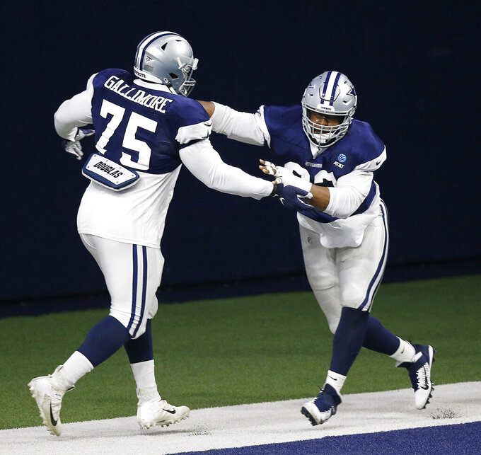 Dallas Cowboys defensive tackle Gerald McCoy (93) runs through a drill with Cowboys defensive tackle Neville Gallimore (75) during NFL football training camp in Frisco, Texas on Monday, Aug. 17, 2020. (Vernon Bryant/The Dallas Morning News via AP)