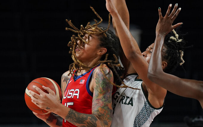 United States' Brittney Griner (15), left, attempts to shoot past Nigeria's Pallas Kunaiyi-Akpanah (3), right, during women's basketball preliminary round game at the 2020 Summer Olympics, Tuesday, July 27, 2021, in Saitama, Japan. (AP Photo/Eric Gay)