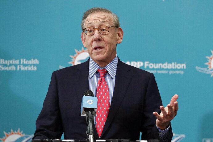 FILE - In this Feb. 4, 2019, file photo, Miami Dolphins owner Stephen Ross speaks in Davie, Fla. Ross, a billionaire New York investor who is hosting a high-dollar fundraiser for President Donald Trump also has a financial interest in the president's business empire. (AP Photo/Brynn Anderson, File)