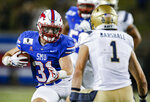 SMU running back Tyler Lavine (31) looks for room as Navy linebacker John Marshall (1) defends during the first half of an NCAA college football game Saturday, Oct. 31, 2020, in Dallas. (AP Photo/Brandon Wade)