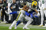 Green Bay Packers wide receiver Allen Lazard makes a catch for a first down while being defended by Detroit Lions cornerback Justin Coleman during the second half of an NFL football game, Monday, Oct. 14, 2019, in Green Bay, Wis. Green Bay won 23-22. (AP Photo/Mike Roemer)