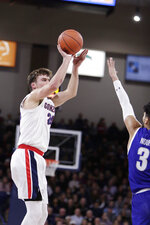 Gonzaga forward Corey Kispert, left, shoots over Texas-Arlington guard Ayoub Nouhi during the first half of an NCAA college basketball game in Spokane, Wash., Tuesday, Nov. 19, 2019. (AP Photo/Young Kwak)