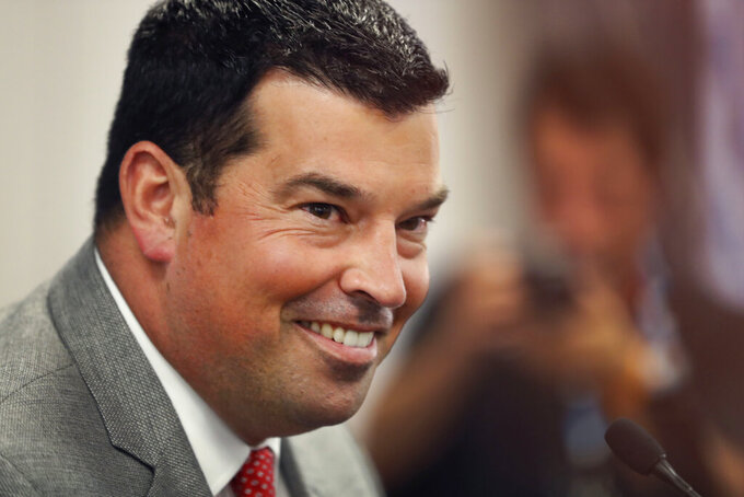 FILE - In this July 18, 2019, file photo, Ohio State head coach Ryan Day smiles as he talks to reporters during the Big Ten Conference NCAA college football media days in Chicago. Day is the man now, named to succeed Urban Meyer when the legendary coach _ who brought a national championship to Ohio State in 2014 _ retired after last season due to health issues.(AP Photo/Charles Rex Arbogast, File)