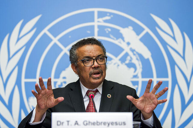 FILE-Int this Feb. 7, 2018 file photo Tedros Adhanom Ghebreyesus, director general of the World Health Organization (WHO), answers questions of the journalists about his first seven months in office and outlines the organization's priorities for the next five years, at the European headquarters of the United Nations in Geneva, Switzerland. The World Health Organization's director-general has faced many challenges during the coronavirus pandemic: racial slurs, death threats, social media caricatures — he was once depicted as a ventriloquist's dummy in the hands of Chinese President Xi Jinping — and U.S. funding cuts. (Martial Trezzini/Keystone via AP)