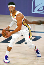 New Orleans Pelicans' Josh Hart handles the ball during the first half of an NBA basketball game against the Sacramento Kings Tuesday, Aug. 11, 2020, in Lake Buena Vista, Fla. (Mike Ehrmann/Pool Photo via AP)