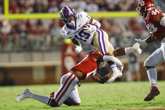 Western Carolina wide receiver Branson Adams (19) is tackled by Oklahoma defensive back Damond Harmon (17) during the second half of an NCAA college football game Saturday, Sept. 11, 2021, in Norman, Okla. Oklahoma won 76-0. (AP Photo/Alonzo Adams)