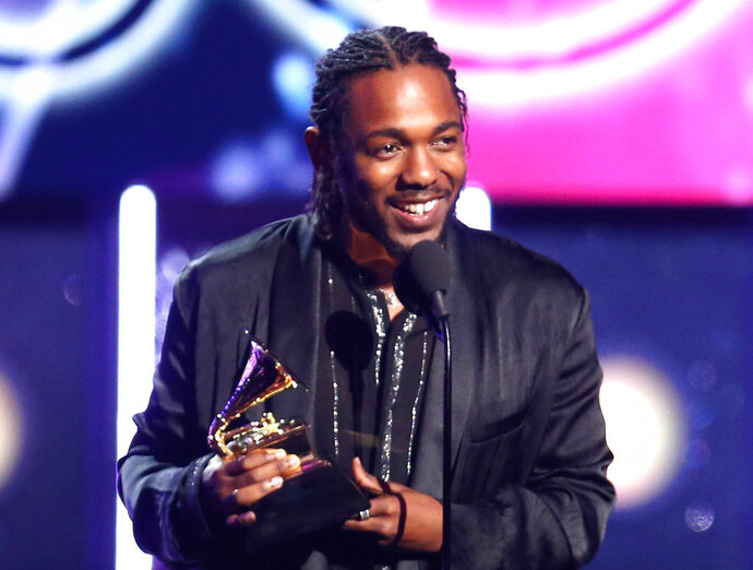 FILE - In this Jan. 28, 2018 file photo, rapper Kendrick Lamar accepts the award for best rap album for