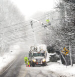 Eversource crew works on a downed line along Sandwich road during a snowstorm, Tuesday, March 18, 2018, in Falmouth, Mass. (Ron Schloerb/Cape Cod Times/The Cape Cod Times via AP)