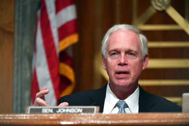 FILE - In this Aug. 6, 2020, file photo, Sen. Ron Johnson, R-Wis., speaks during a Senate Homeland Security and Governmental Affairs Committee hearing on Capitol Hill in Washington. Johnson is defending his committee's investigation into Ukraine and Joe Biden from criticism that his probe is politically motivated and advancing Russian interests. Johnson says in an interview with The Associated Press that he has never used Russian disinformation. (Toni Sandys/The Washington Post via AP, Pool)