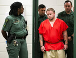 Michael W. Jones Jr. walks into the Marion County Jail courtroom for his initial appearance, Thursday, Sept. 19, 2019 in Ocala, Fla. Jones, suspected of killing his wife and four children and driving their bodies into Georgia, returned to Florida to face murder charges. (Doug Engle/Star-Banner via AP)