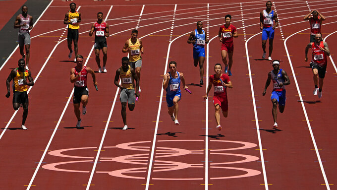 Zhiqiang Wu, of China anchors his team to win a semifinal of the men's 4 x 100-meter relay at the 2020 Summer Olympics, Thursday, Aug. 5, 2021, in Tokyo, Japan. (AP Photo/Charlie Riedel)