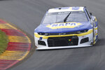 Chase Elliott (9) drives up the esses during Stage 1 of a NASCAR Cup Series auto race in Watkins Glen, N.Y., on Sunday, Aug. 8, 2021. (AP Photo/Joshua Bessex)