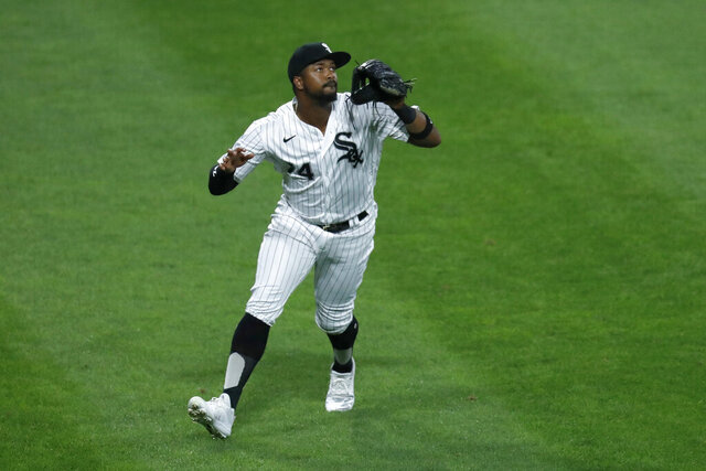 Chicago White Sox left fielder Eloy Jimenez keeps an eye on a fly ball during the fifth inning of a baseball game against the Cleveland Indians Friday, Aug. 7, 2020, in Chicago. (AP Photo/Charles Rex Arbogast)