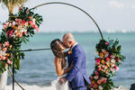 Ryan Rutledge kisses his bride Natalie LaRocca at the Postcard Inn Beach Resort and Marina in Islamorada, Fla., after their wedding was officiated by Associated Press sportswriter Larry Lage on March 27, 2021. (Photo courtesy of Lukas Guillaume via AP)
